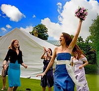 The throwing of the bouquet and being caught by thrilled wedding guest.