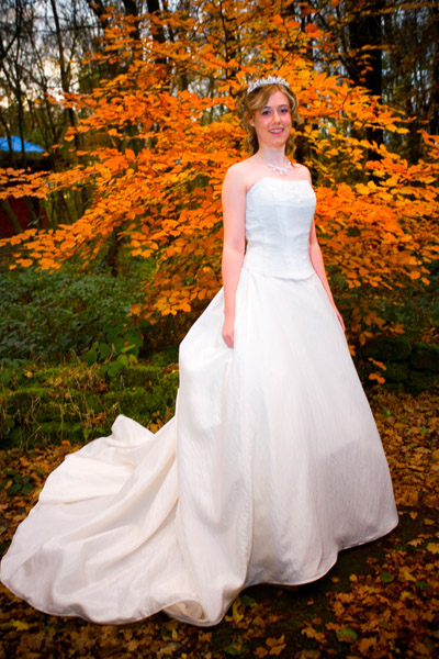 winter bride by Autumn leaves in hotel grounds at Chevin Lodge in Otley