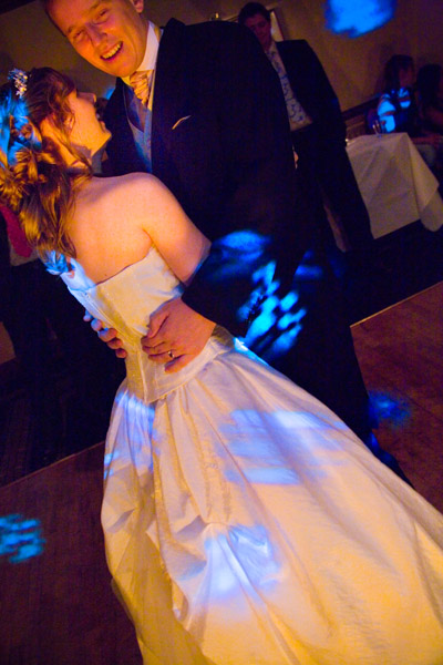 first dance with colourful disco lighting at Chevin Lodge Hotel in Otley