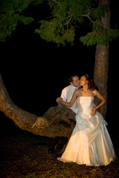 Kiss under the tree at night outside