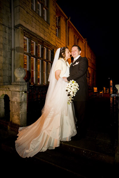 bridal portrait outside Monk Fryston Hotel at night