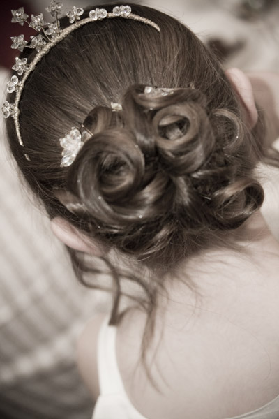 Sepia photos of back of bridesmaid's hair