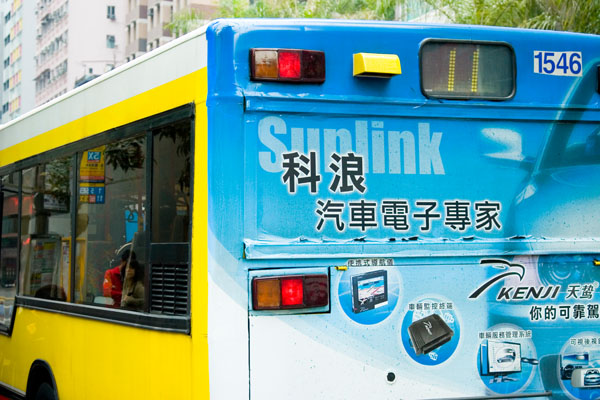 blue and yellow bus in Hong Kong