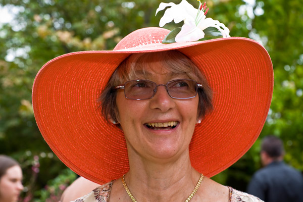 Delighted groom's Mum Bron in a wide brimmed wedding hat