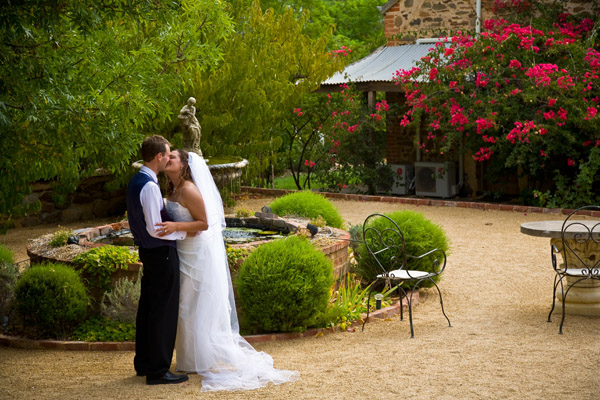 bride and groom by fountain at Jacobs Creek Retreat in Barossa Valley South Australia