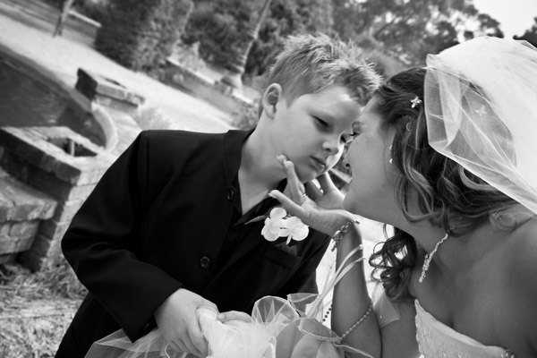 black and white photo of bride with son by after wedding at Jacobs Creek Retreat in Barossa Valley Australia