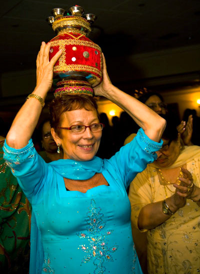 French Bridegroom's mother carrying Sikk wedding jug -lantern