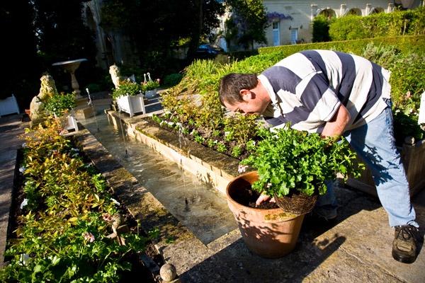 Thierry, the gardener at Chateau de Tilly, rushes round to prepare for the wedding