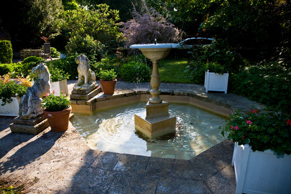 beautiful morning light on fountain in gardens at Chateau de Tilly, Loire Valley, France