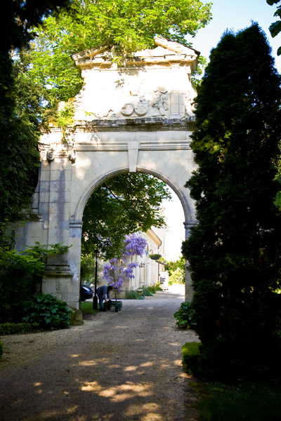 wedding morning light on archway in grounds of Chateau de Tilly in Loire Valley, France
