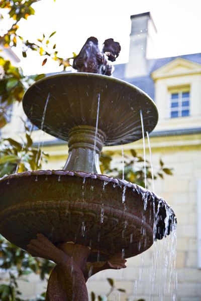 fountain with steady trickle of water at Chateau de Tilly