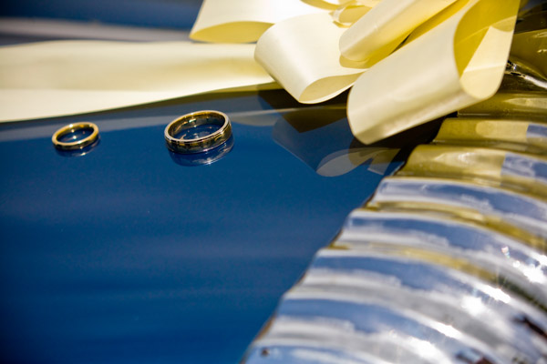 wedding rings on wedding car bonnet