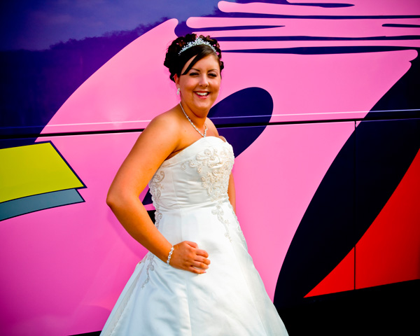 bride at Gomersal Park Hotel, West Yorkshire, against a colourful bus.