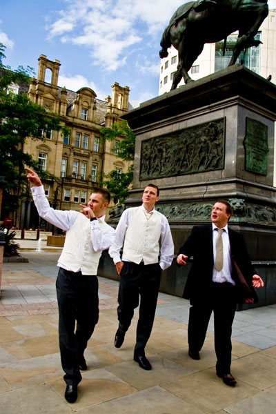 Groomsmen walking  Leeds city centre wedding between rain showers