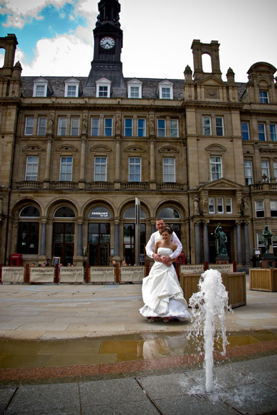 Bride and bridegroom on rainy day in centre of Leeds