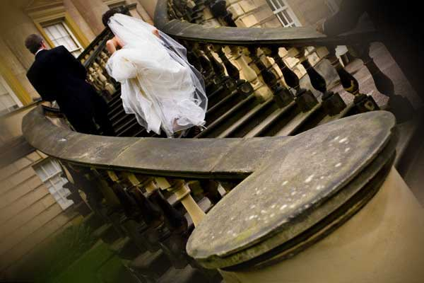 bride and groom on the steps at Nostell priory near Wakefield