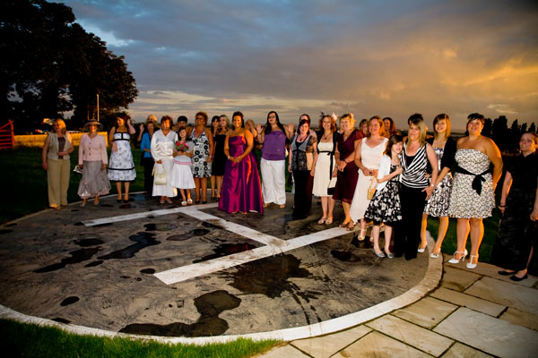 sunset family wedding group photo on helipad at Kings Croft Pontefract