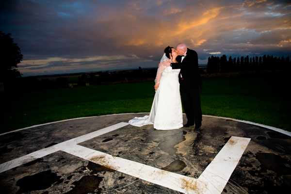 sunset wedding kiss on the helipad at Kings Croft in Pontefract