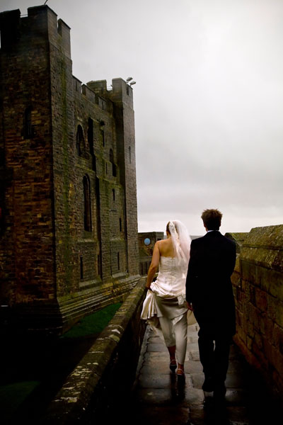 rainy day wedding photos at Bamburgh Castle in Northumberland