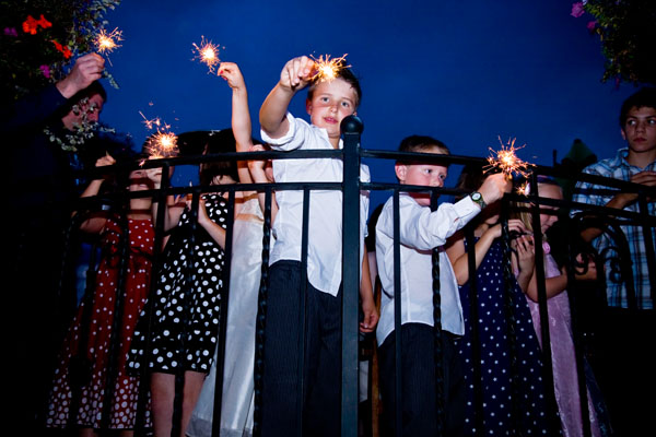 wedding fireworks; children with sparklers at evening wedding reception