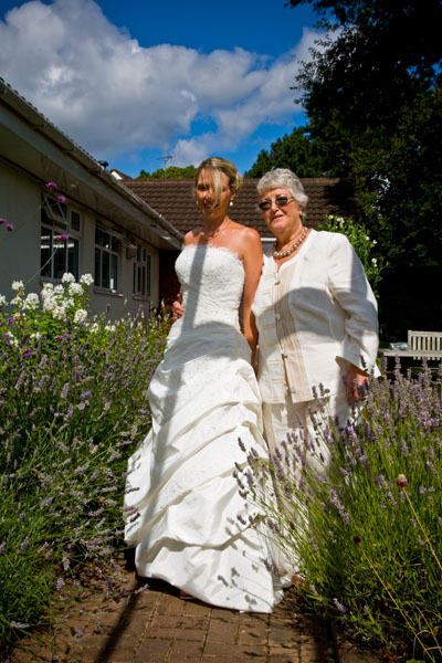bride with her Mum in the garden before going to the wedding ceremony