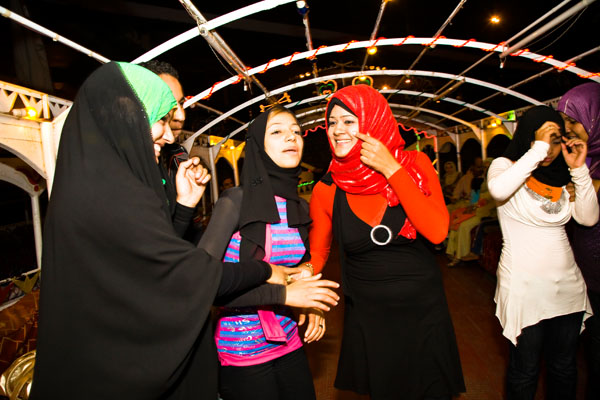 Egyptian girls dancing on boat on river Nile
