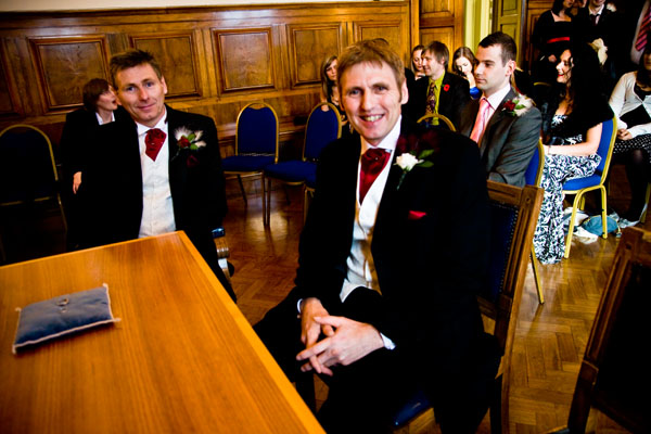 bridegroom eagerly awaits his bride at Sale register Office near Manchester Airport