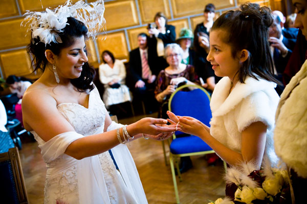 bride gives her daughters presents during wedding vows