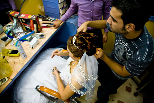 putting on Egyptian bride's veil