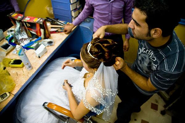 putting on Egyptian bride's veil