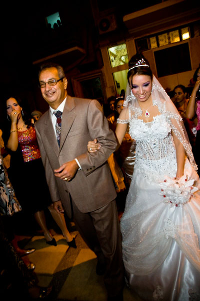 Egyptian bride arrives to be given away by her father