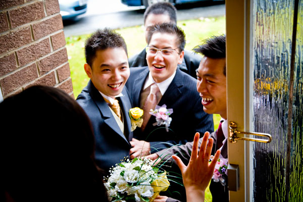 Chinese wedding forfeits outside Bride's parents house