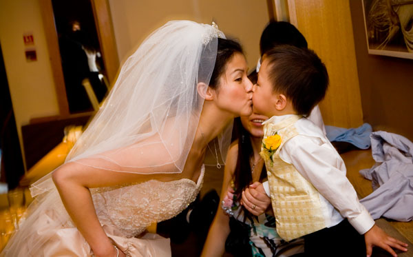 Kiss for a little boy after Weetwood Hall wedding ceremony