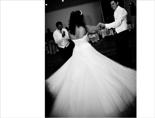 black and white photo of bride's dress twirling