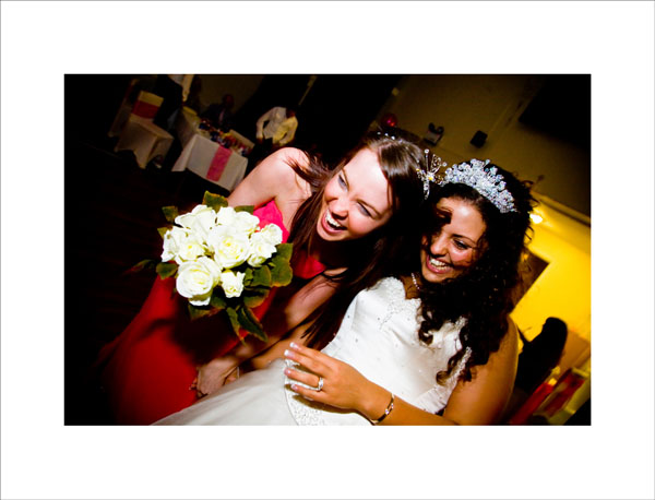 bride hugs bridesmaid who caught the bouquet