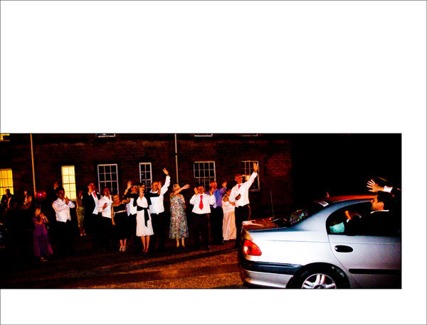 groom waves out of the car as they all shout goodnight