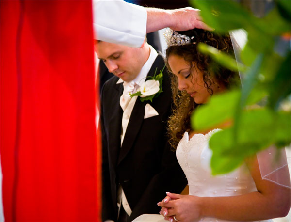 bride and groom kneeling for church wedding blessing