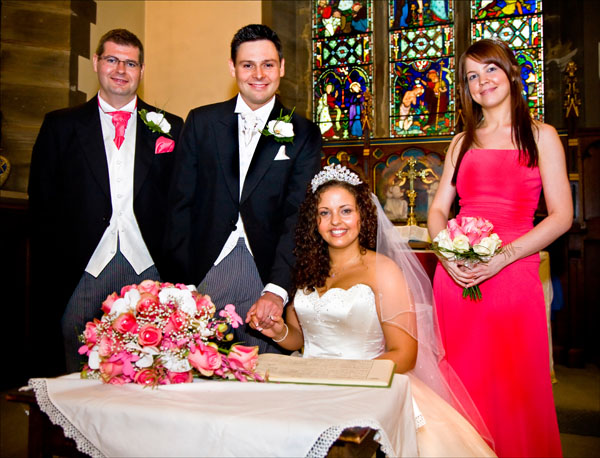 traditional posed wedding photo in church