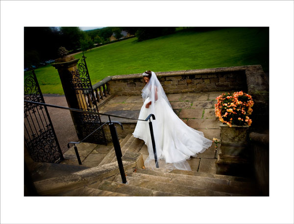 bride walking through gates at Woolley Hall