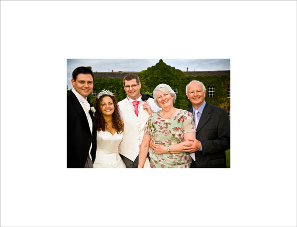 best man and his family at summer wedding