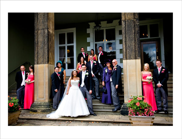 bridal party group wedding picture on steps in front of Woolley Hall