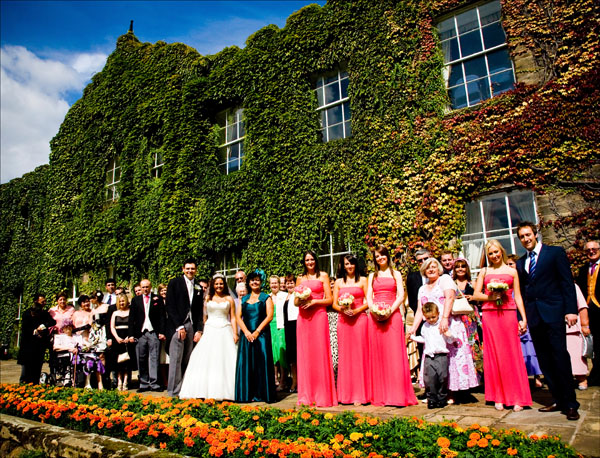 whole group summer wedding picture outside Woolley Hall