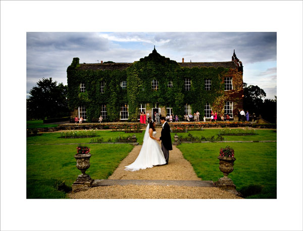 summers evening wedding picture outside Woolley Hall