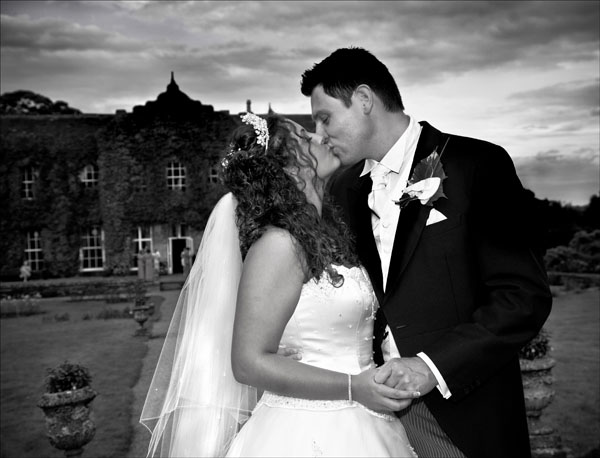 black and white wedding picture sealed with a kiss
