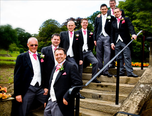 groomsmen on steps at back of Woolley hall