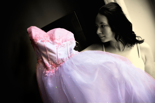 natural light photo with artistic colouring of winter bride by Met hotel window in Leeds
