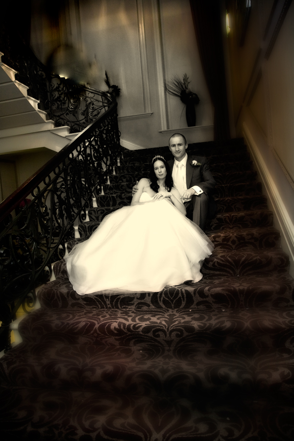 Winter wedding indoor picture of bride and groom on staircase of Leeds Hotel Metropole