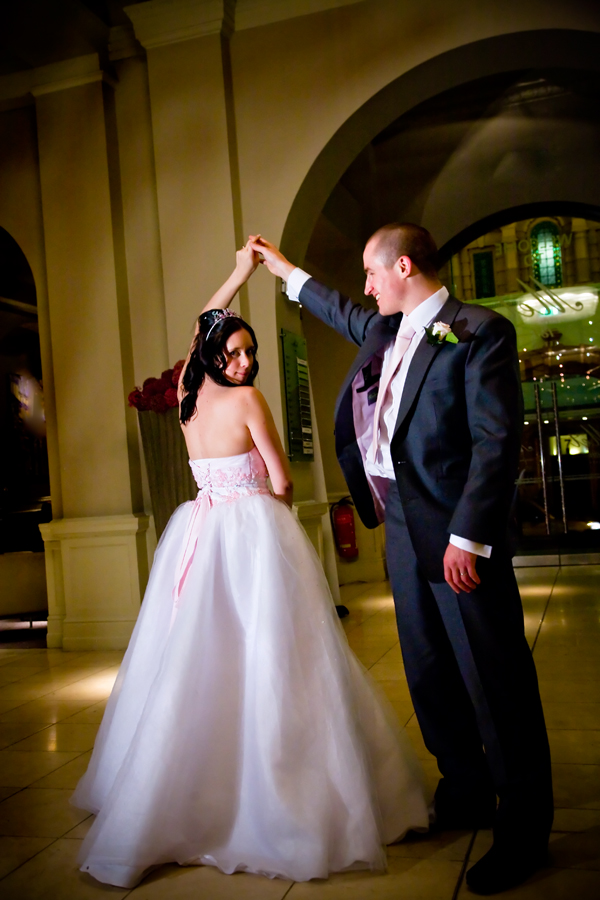 bride and groom praticing their first dance in Leeds hotel foyer