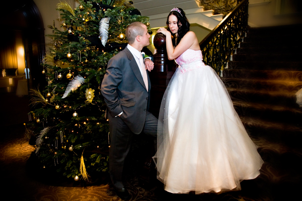 bride and groom by Christmas tree inside Hotel Metropole in Leeds