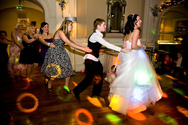 conga dance during evening winter wedding reception in Leeds